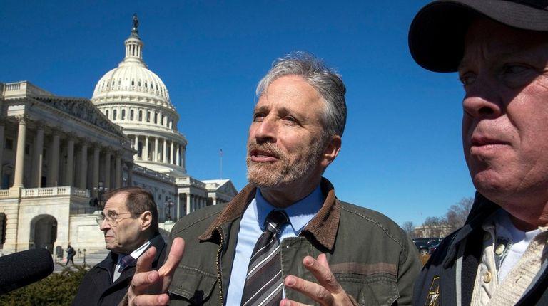 Jon Stewart, flanked by Rep. Jerrold Nadler, left,