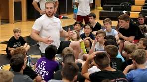 Olympic gold medalist Kyle Snyder speaks to a