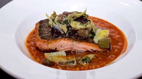 Salmon with tomato-fennel broth and couscous at Harley's