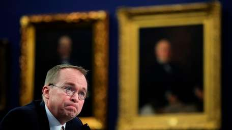 Budget director Mick Mulvaney, who proposed merging the