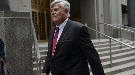 Dean Skelos exits a federal courthouse in Manhattan