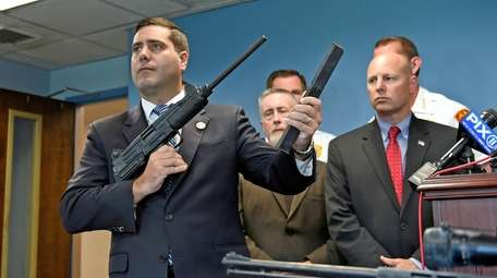 Suffolk County District Attorney Timothy Sini shows a