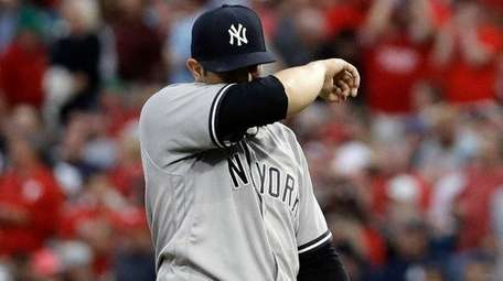 Yankees pitcher Luis Cessa reacts after giving up
