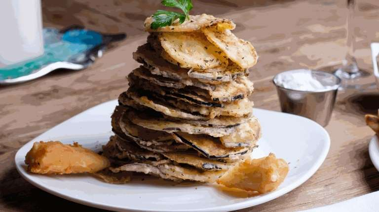 Kolokithakia Tiganita, a tower of thin sliced zucchini,