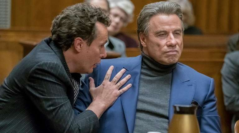 "John Travolta, right, in a scene from ""Gotti."""