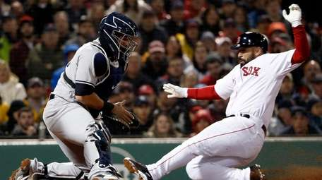 Sandy Leon of the Red Sox scores as