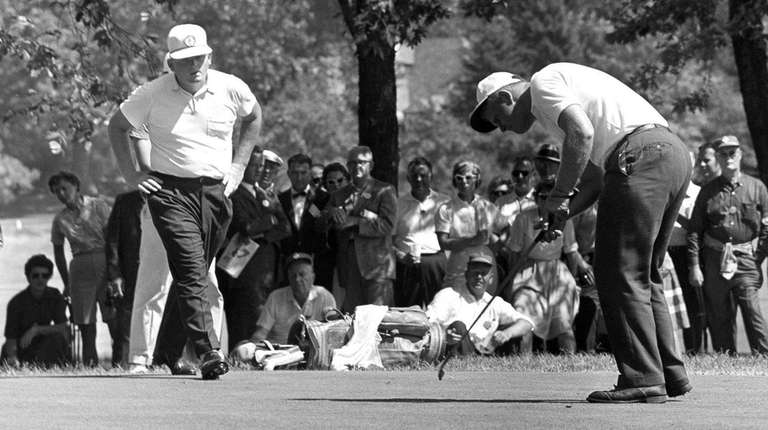 Jack Nicklaus, right, drops a short putt on