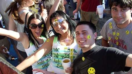Party-goers smile for the camera on opening day