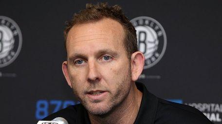 Nets GM Sean Marks talks to the media