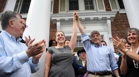 Democratic primary winners Liuba Grechen Shirley, left, and