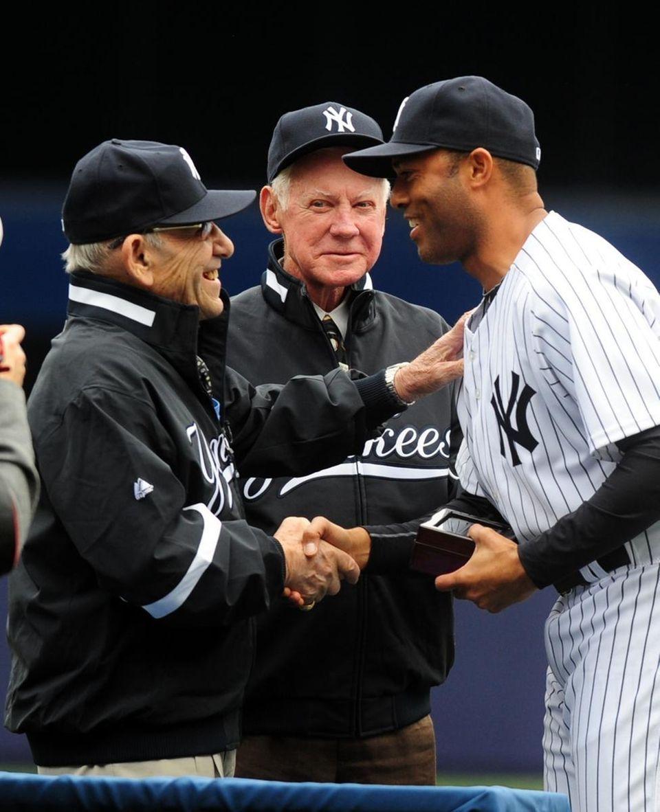Yankees MAriano RIvera is congratulated by Yogi Berra