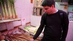 Joey Campanaro checks out burdock root in Chinatown.