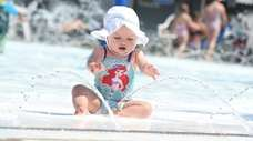 Gianna Bucaro, 8 months old, of Islip, cools