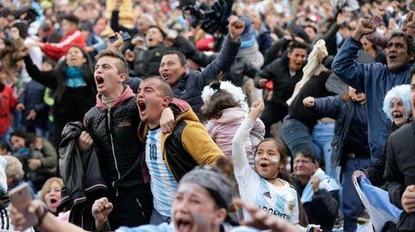 Argentina soccer fans celebrate Argentina's goal.