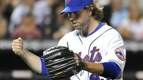 Mets' pitcher, R.A. Dickey pumps his fist after