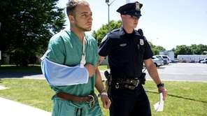 Matthew J. Byank of Manorville, is escorted into