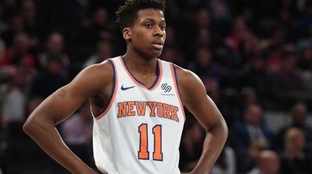 Knicks guard Frank Ntilikina looks on during a