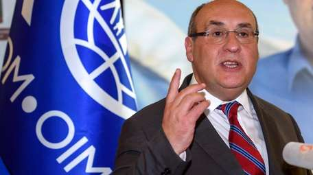 Portugal's Antonio Vitorino gives a speech after being