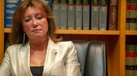 Katuria D'Amato speaks at her attorneys office on