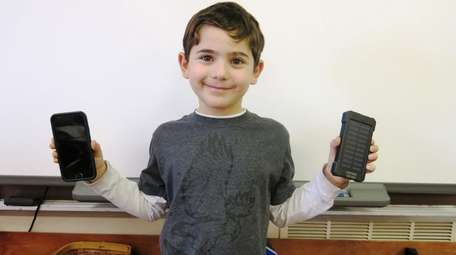 Kidsday reporter Evan Koutsogiannis with his phone and