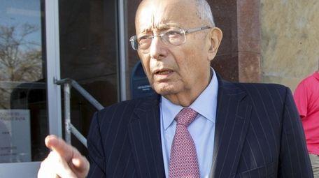 Former Senator Alfonse D'Amato leaves the Nassau County