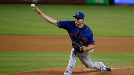 Mets' Corey Oswalt delivers a pitch during the