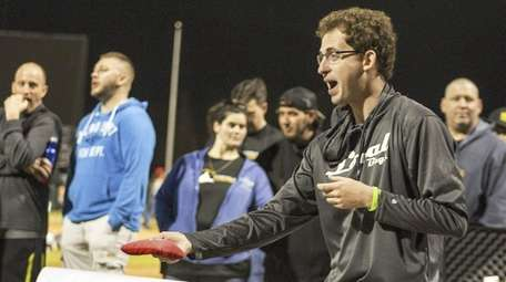 Top-ranked player Cody Henderson competes in a cornhole