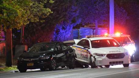 A parked Hempstead police car was struck early