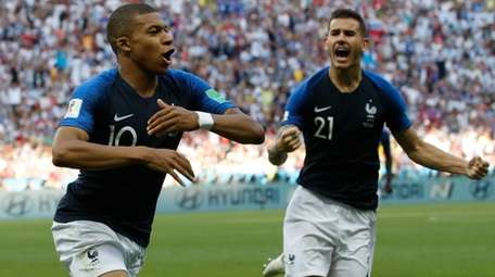 France's Kylian Mbappe, left, celebrates with teammate Lucas