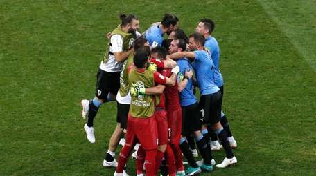 Uruguay players celebrate during the round of 16
