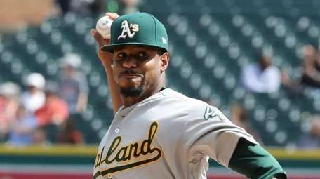 Oakland Athletics starting pitcher Edwin Jackson throws during