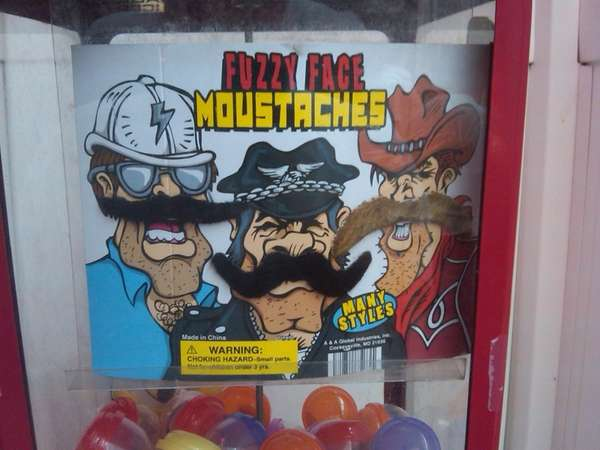 Fake mustache vending machine outside of Ralph's Italian
