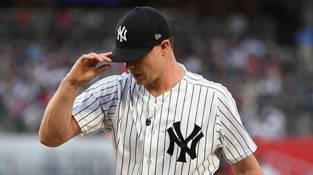 Yankees pitcher Sonny Gray walks to the dugout