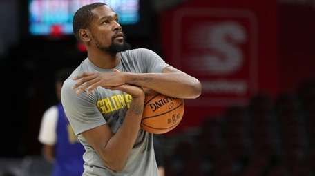 Golden State Warriors forward Kevin Durant warms up