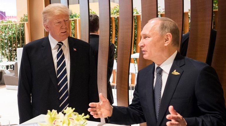 President Donald Trump meets Russian President Vladimir Putin