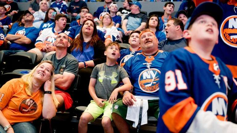 Fans watch intently as the Islanders announce their