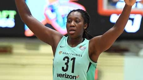 Liberty center Tina Charles reacts to a three-point