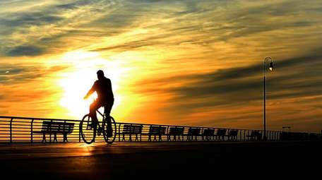A bicyclist on the Long Beach Boardwalk. Exercise
