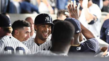 Yankees centerfielder Aaron Hicks is greeted in the