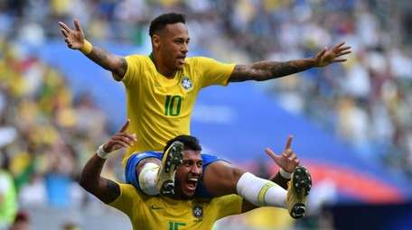 Neymar celebrates with Paulinho after scoring the opening