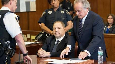 Harvey Weinstein, seated, with his attorney, Benjamin Brafman,