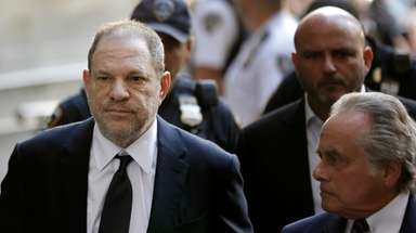 Harvey Weinstein arrives in a New York courtroom