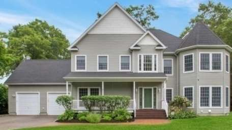 This Colonial with five bedrooms and four bathrooms,