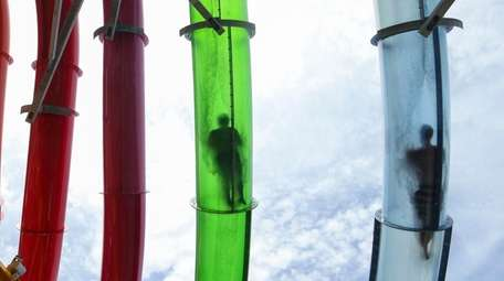 Riders shoot through the winding, translucent tubes of