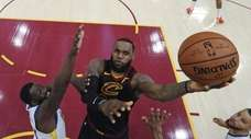 LeBron James of the Cavaliers tries to score