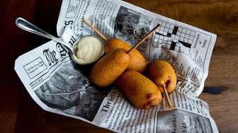 Miniature smoked-sausage corn dogs come with spicy mustard
