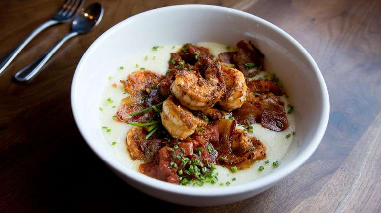 Charred jumbo shrimp over manchego-laced grits is punched
