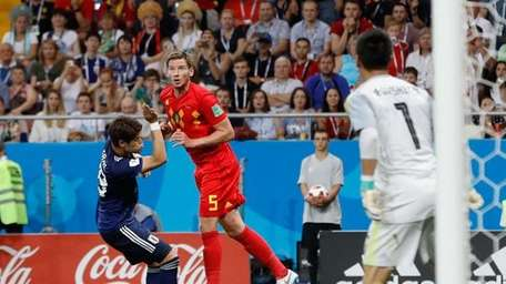 Belgium's Jan Vertonghen, second left, heads the ball