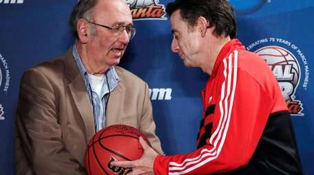 AP college basketball writer Jim O'Connell, left, is