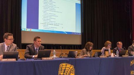 Massapequa school board trustees at their April 11